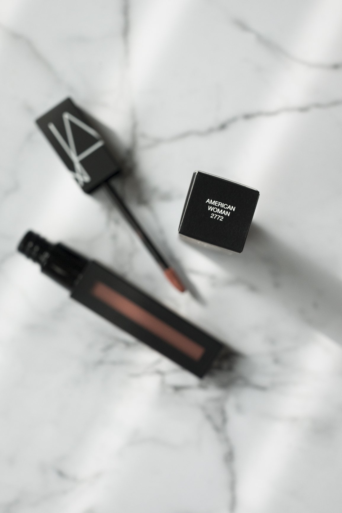 Nars Powermatte Lip Pigment in American Woman on marble table