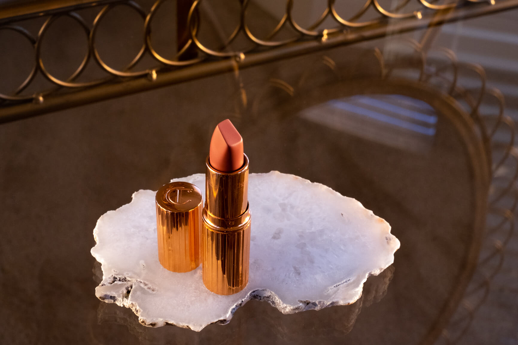 Charlotte Tilbury Pillow Talk lipstick bullet on vanity table