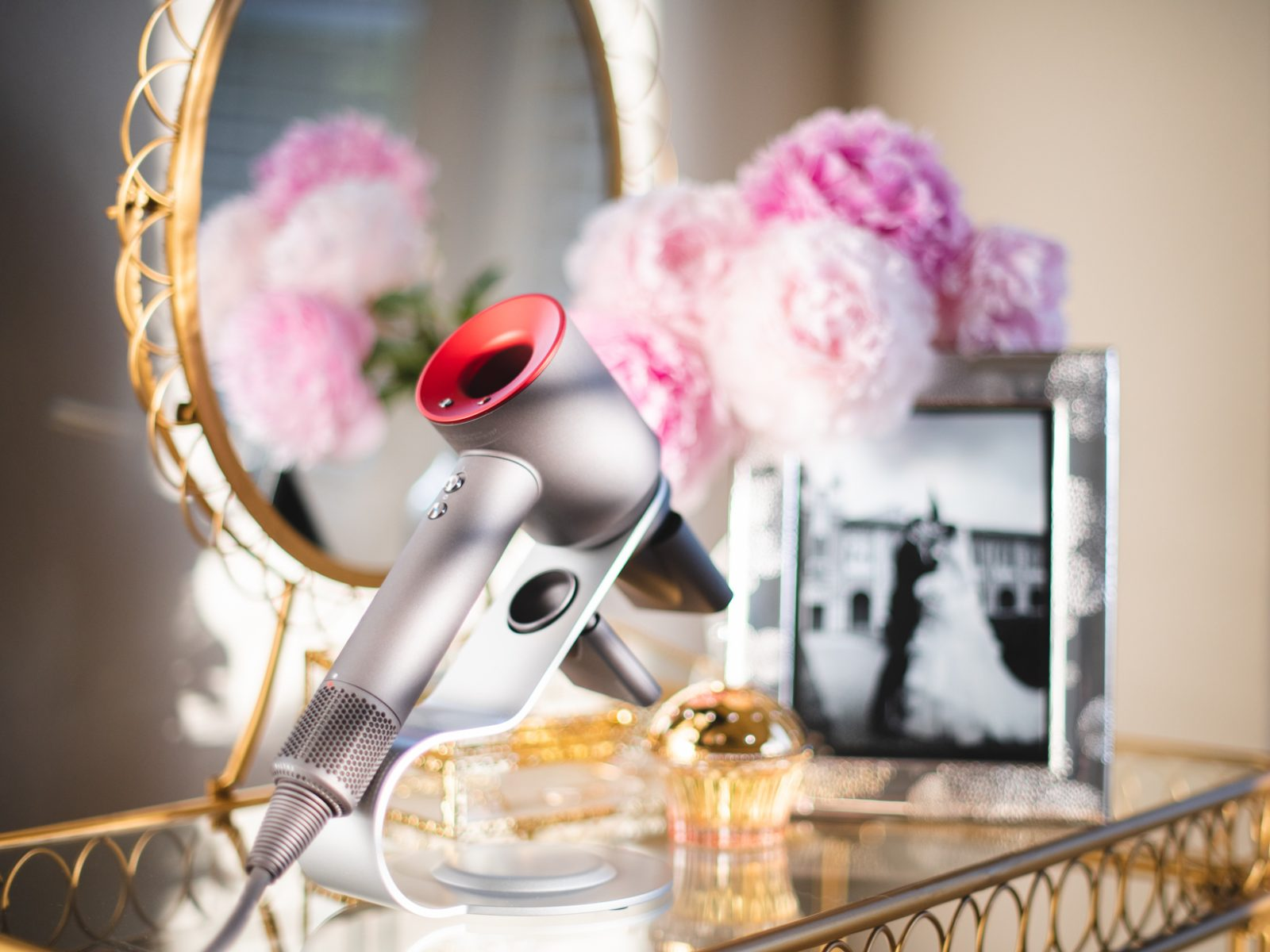 Dyson Hairdryer with a stand on vanity table
