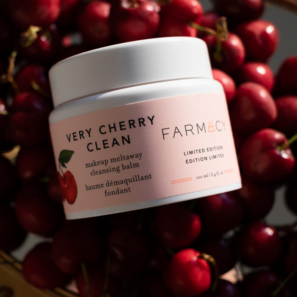 Farmacy Beauty Very Cherry Makeup Meltaway Cleansing balm on a pile of fresh cherries