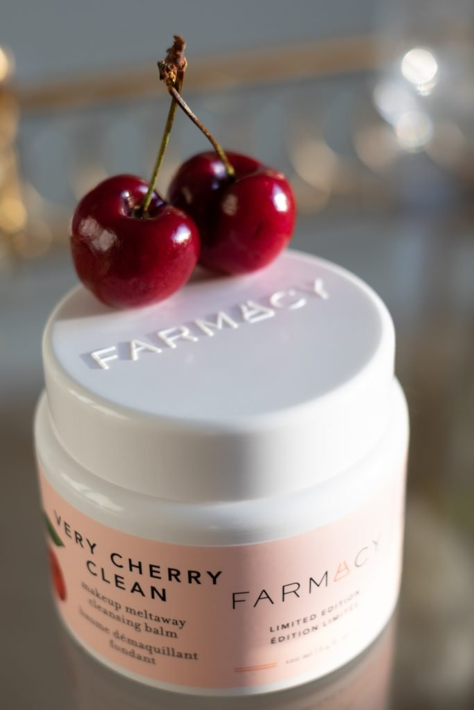 Fresh cherries on Farmacy Beauty Very Cherry cleansing balm