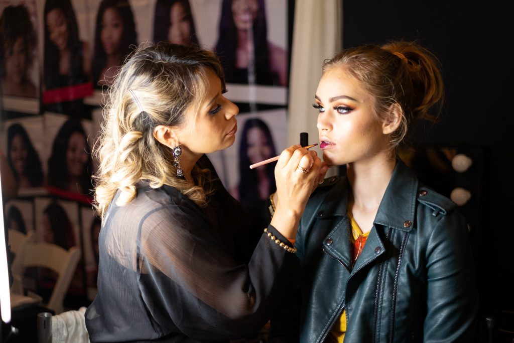 Makeup artist applying makeup on a model